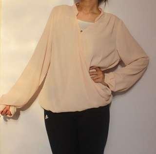 The executive pink sheel blouse