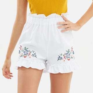 The iconic white shorts