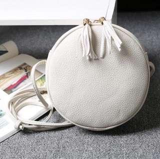 ROUND LEATHER WHITE SLING BAG