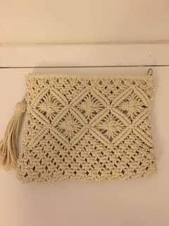 Ivory colored clutch bag
