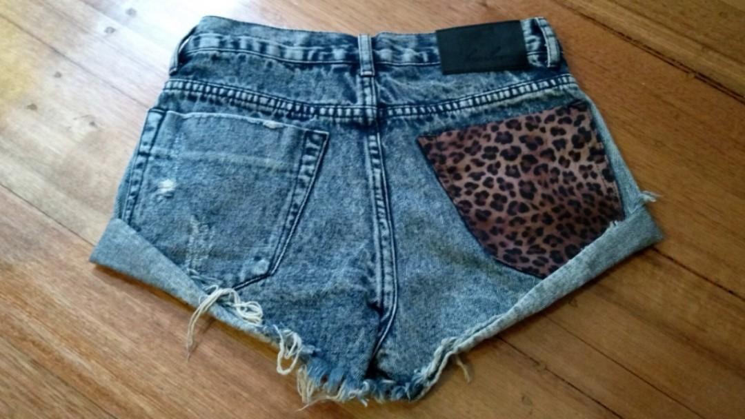 Distressed leopard denim shorts