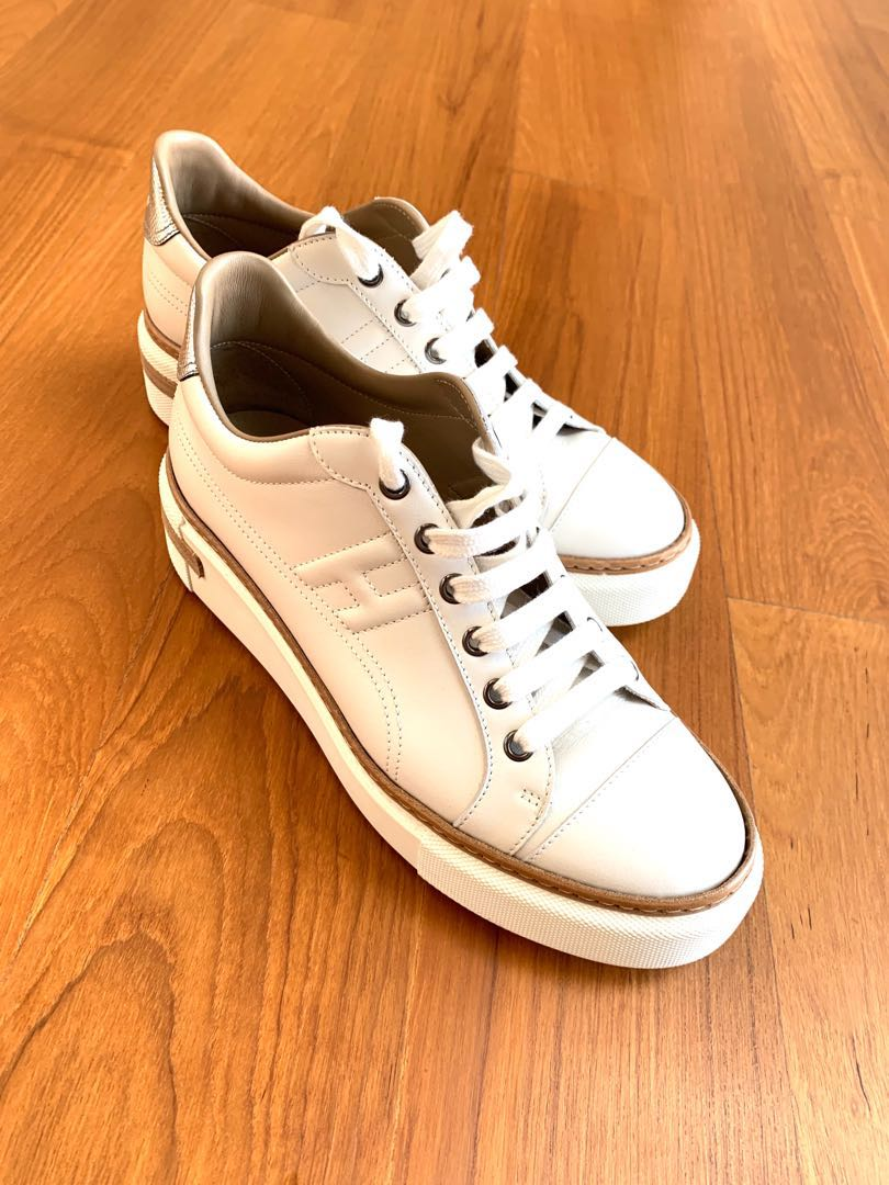 3b4a8cb9d98c Hermes Polo Sneakers in White with silver trimmings