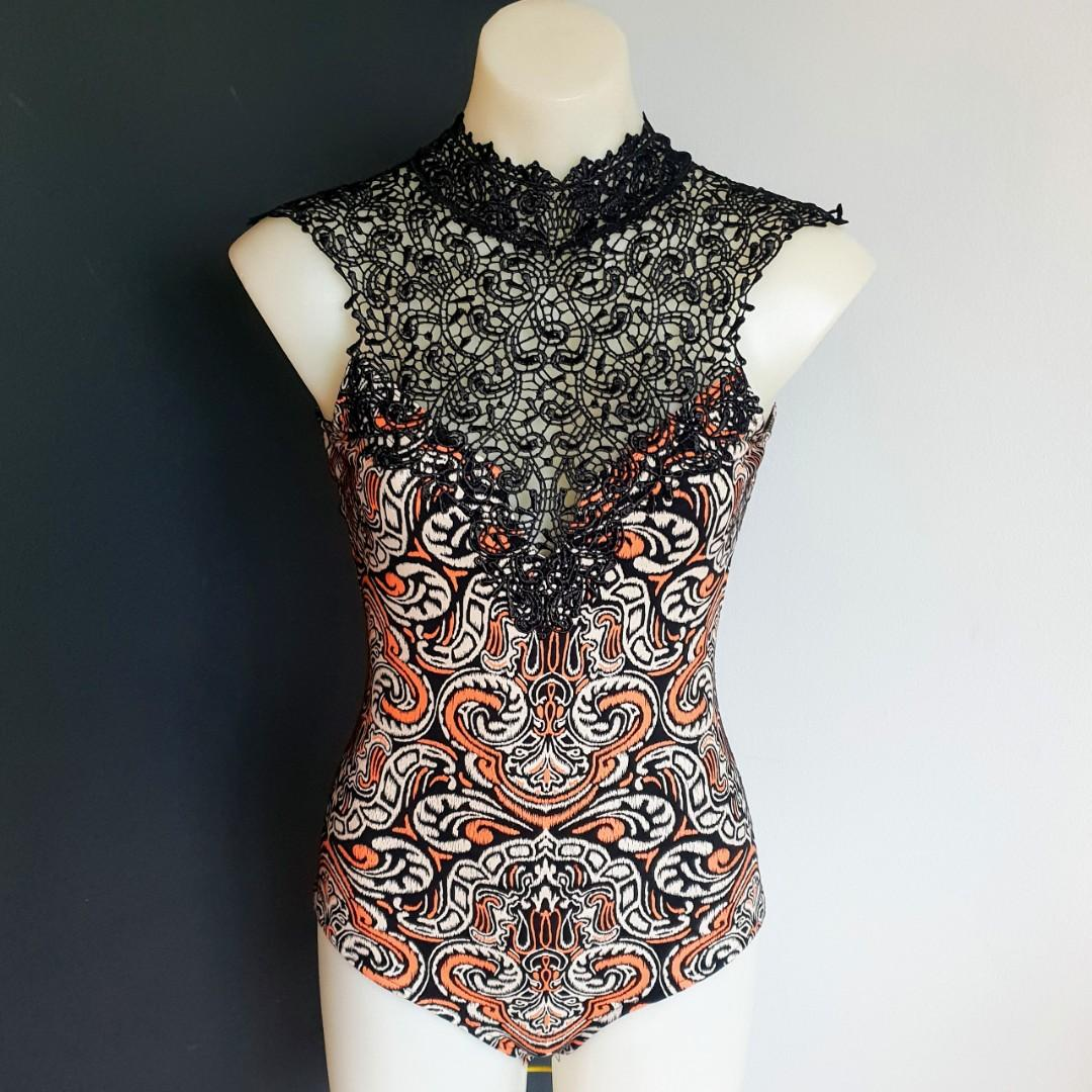 Women's size 10 'ANGEL BIBA' Stunning black/orange high neck crotchet bodysuit