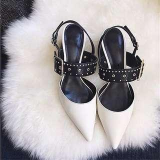 Pointed white bucket heels