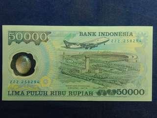 di cari uang kuno suharto sperti ini namun yang huruf serinya XZZ atau X--