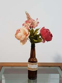 Retro bottle with fabric flowers