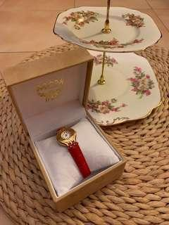 Auth MCM stunning red and golden shades Ladies watch in box like new with red swarosky elements with new strap