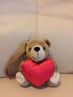 Toy bear with belt and back pack