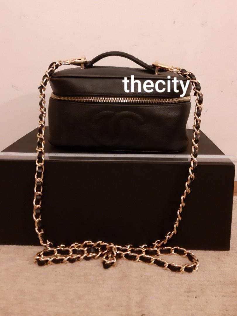 AUTHENTIC CHANEL VANITY BAG- BLACK CAVIAR LEATHER - CC LOGO DESIGN - OVERALL GOOD, CLEAN INTERIOR & SOLID SHAPE STRUCTURE- HOLOGRAM NOT INTACT- REPLACEMENT ZIP PULL TAB- (CHANEL VANITY BAGS NOW RETAIL AROUND RM 15,000+) -