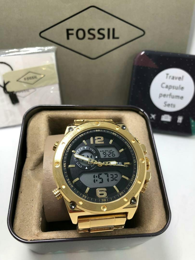 BRAND: FOSSIL  DESCRIPTION: Men watch Grade  1.1 Dual Time Stainless Steel Band  Warranty 2Month Engine
