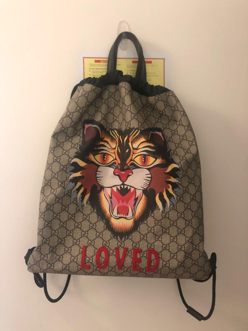 76eac263 Gucci GG Supreme Soft Drawstring Backpack Angry Cat Print Beige ...