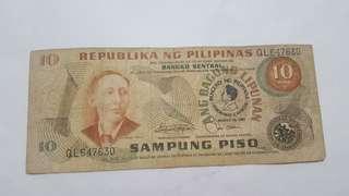 10 peso bill with marcos logo