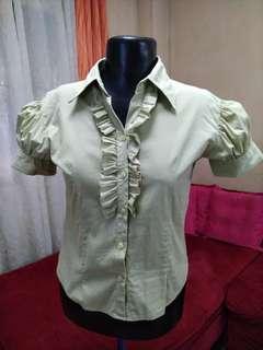 Green ruffled button-down blouse