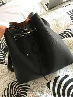 Reversible lightly used GUESS bucket bag