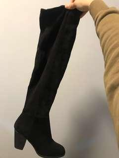 Above-the-knee black suede boot