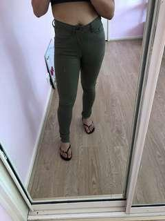Green high-waisted jeans