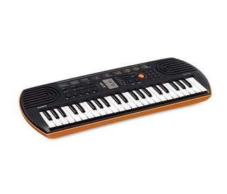 BN Casio SA76 44-Key Portable Keyboard Synthesizer 100 Tones 44 Mini Keys , Orange / Pink