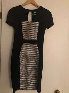 Stretch bodycon black and white Yoana Baraschi dress