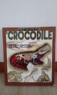 Educational book with 3D model on crocodile