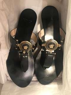 🚚 Versace black sandal with gold embelli