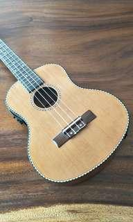 Brand new Tenor Ukulele with Solid Cedar top with built in EQ/Tuner