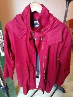 Jaket warna merah merek MKY