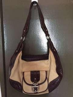 Authentic Etienne Aigner Canvas with leather trim.