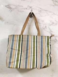 Striped canvas shoulder tote bag.