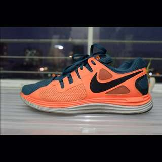 best sneakers cd3a1 de619 Nike Lunarlon Orange Running Shoes with Nike+ Sensor Kit