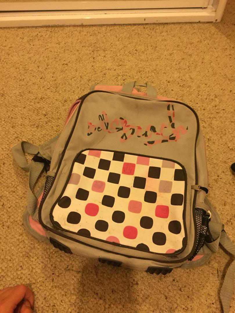 Canvas pink and grey backpack with multiple compartments