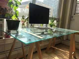 IKEA glass desk with wooden legs