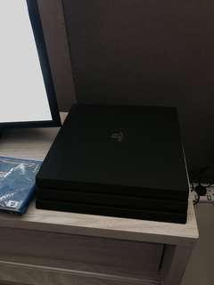 PS4 Pro with Games and Warranty