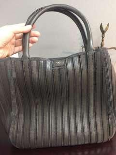 Anya Hindmarch (with leather strap)
