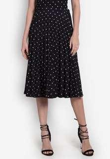 Polka dotted skirt electric pleats