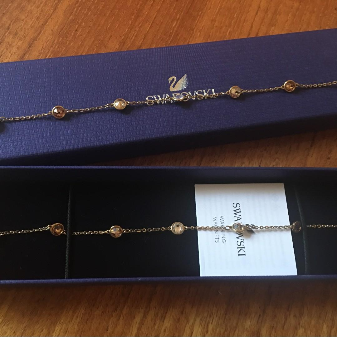 Swarovski Remix Gold Bracelet ( size M ) great conditions!