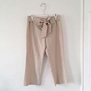 Nude pink belted pants