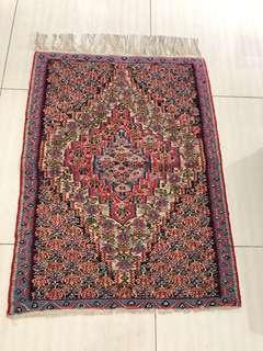 Handcrafted Persian rug