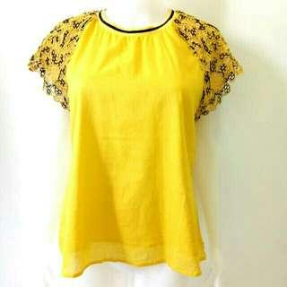 Yellow blouse with brocade sleeves