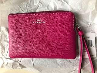 Coach pink wristlet ( reduced to clear)