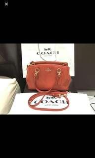 Coach hand and sling bag