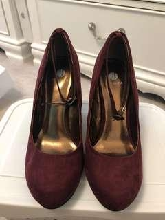 Deep burgundy pumps with straps