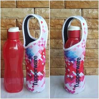 Bottle with pouch