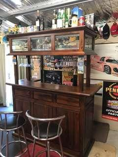 Entertainment bar and two stools
