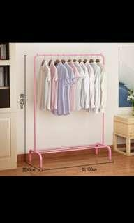 Pink clothes hanging rack clothes drying rack