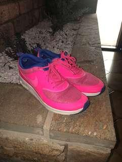 Pink and blue nike theas