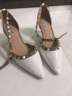 White heels with gold studs