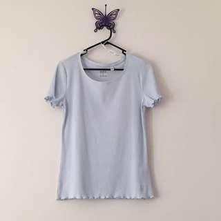white blue lettuce hem shirt