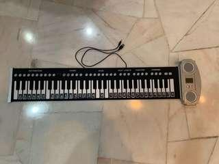 Portable roll up Electronic Piano keyboard.