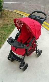 Graco lightly used baby pram stroller, RED, 3 back positions including fully flat. Removable front tray.
