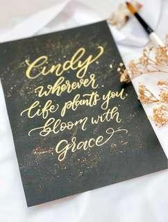 Gold calligraphy on black cards